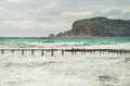 View over Alanya castle hill, stormy Mediterranean sea and pier Royalty Free Stock Photo