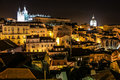 View over alfama quarter at night lisbon portugal the district seen from the viewpoint miradouro de santa luzia Royalty Free Stock Image