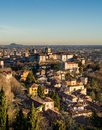 View over Citta Alta or Old Town buildings in the ancient city of Bergamo, Lombardia, Italy on a clear day, taken from Royalty Free Stock Photo