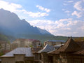 View over a city in the mountains old and new houses Royalty Free Stock Image