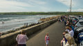 View over Lahinch boulevard with many tourists enjoying a beauti