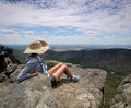 View over national park woman viewing from lookout at grampians Royalty Free Stock Photography