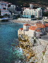 View over the old town buildings on a cliff beach and hotel from the top of the ancient citadel in budva montenegro january Stock Photos