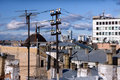 View over the rooftops with antennas and cables Royalty Free Stock Photo