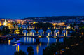 View over the vltava river and bridges in prague night at sunset czech republic Stock Photography