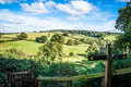 View past footpath sign towards rolling hills Petw Stock Image