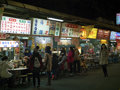 View of people eating in restaurant at Liaoning Street night mar