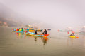View of phewa lake in pokhara nepal with colourful boats and people Royalty Free Stock Photos