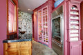 View of pink storage built ins small room with and stone wall in cabinets Royalty Free Stock Photos