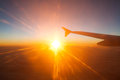 View from the plane on a beautiful orange sunset travel Stock Image