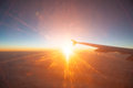 View from the plane on a beautiful orange sunset travel Stock Photos