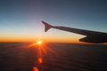 View from the plane on a beautiful orange sunset travel Stock Photo