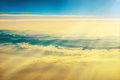 View from a plane to sunset on the sky with sunrays fluffy clouds background Royalty Free Stock Photos