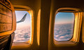 View from the plane window while is above clouds Royalty Free Stock Image