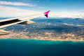 View from the plane window aerial of mediterranean coast seen cabin of passenger Royalty Free Stock Image