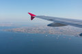 View from the plane on the wing sea and land Royalty Free Stock Photography