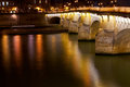View of pont neuf through seine river in paris at night Royalty Free Stock Photos