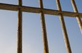 View from a prison blue sky seen through rusty bars Stock Photos
