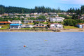View of puget sound neighborhood a a beautiful waterfront homes at low elevation on a slight hill under blue skies in Royalty Free Stock Images
