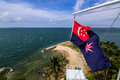 View from raffles lighthouse and the state marine ensign of straits of singapore southern islands pulau setumu Stock Image