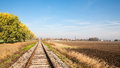View of the railway track across a typical autumn agricultural rural countryside Royalty Free Stock Images