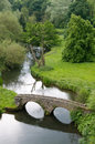 View of river and stone arched bridge Royalty Free Stock Photo