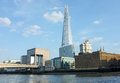 View from the river thames across the embankment with the shard rising high above the other waterfront buildings the shard Royalty Free Stock Photography