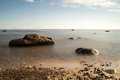 View of a rocky coast in the morning long exposure shot Royalty Free Stock Photo