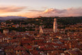 View of rooftops in verona from the lamberti tower duomo and sanatorium maria de lourdes torre at sunset Stock Images