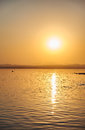 View of the salt lake with a beautiful pink water. Sunset orange sun, the neighborhood.Las salinas, Torrevieja, Spain Royalty Free Stock Photo