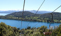 The view at the scenery of patagonia from a overhead cable cart moving upwards Stock Photos