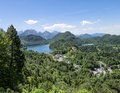 View of schwangau town and alpsee lake photoshoot from hohenschwangau castle hill in bavaria germany Stock Photos