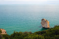 View of sea and rocky wooded coast Royalty Free Stock Photo