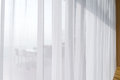 view seascape looking pass Translucent white fabric curtains and Royalty Free Stock Photo