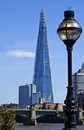 View of the shard in london a across river thames taking sights southwark cathedral and southwark bridge Royalty Free Stock Photos