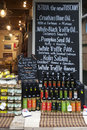 View of shopboard with bottles puring virgin olive oil Royalty Free Stock Photo