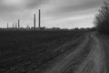 View of smoking coal power plant black and white Stock Photo