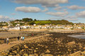 View from St Michaels Mount to Marazion Cornwall with people crossing the causeway Royalty Free Stock Photo