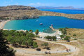 View of st paul s bay lindos rhodes greece the old village at island donkey ride for tourists to the acropolis Royalty Free Stock Image