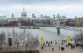 View st paul s cathedral millennium bridge london city skyline tate gallery balcony tourists people walking along embankment Stock Photos