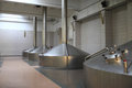 View of stainless fermentation vats at a brewery Royalty Free Stock Images