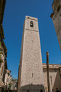 View of stone steeple tower next to church in Saint-Paul-de-Vence. Royalty Free Stock Photo