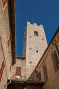 View of stone steeple tower next to church in Vence. Royalty Free Stock Photo