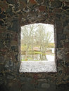 View through stone window in the wall of castle. Royalty Free Stock Image