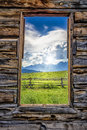 View of the tetons through a cabin window late afternoon from inside abandoned that was used for filming movie shane Royalty Free Stock Photo