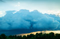 View of thunderstorm clouds above the forest Stock Images
