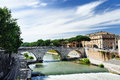 View of Tiber Island across Tiber River with ancient Roman stone bridge Pons Cestius in Rome, Italy Royalty Free Stock Photo