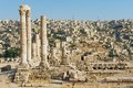 View to the ancient stone columns at the Citadel of Amman with the Amman city at the background in Amman, Jordan. Royalty Free Stock Photo