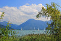 View to cruising sailboats and wallberg, lake tegernsee Royalty Free Stock Photo