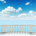 View to the sea from a balcony under cloudy sky Stock Photography
